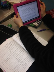 Students work with digital and paper resources.